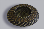 <strong>Woven Basket</strong><br /> Carolyn Zeitler&rsquo;s intricate basket image had to reveal the rich texture of the pine needles.
